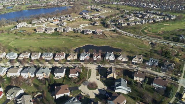 Aerial panoramic view of the residential neighborhood Libertyville, Vernon Hills, Chicago suburban area, Illinois. Cinematic aerial drone video with the static camera.