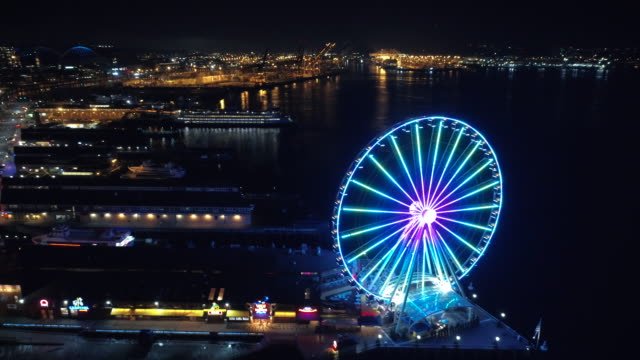Aerial Passing Bright Seattle Waterfront Lights at Night video