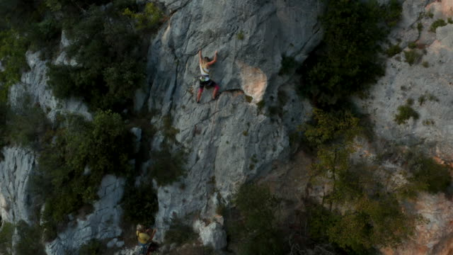 Aerial perspective of female climber on multi pitch route