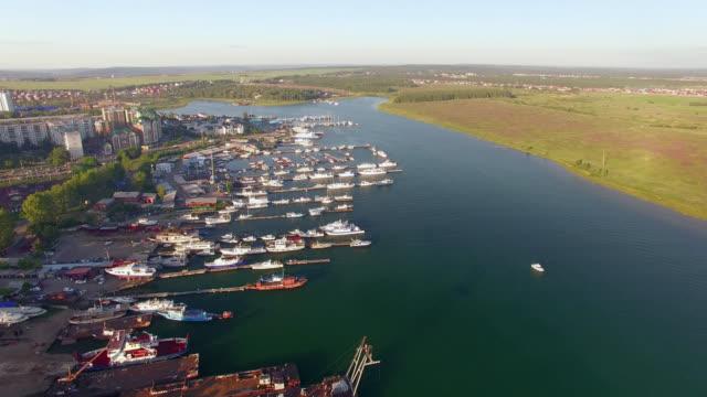 vídeos de stock e filmes b-roll de aerial photo. city yacht club at sunset - irkutsk