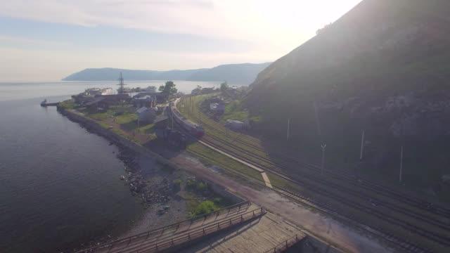vídeos de stock e filmes b-roll de aerial photo. port baikal at sunset - irkutsk