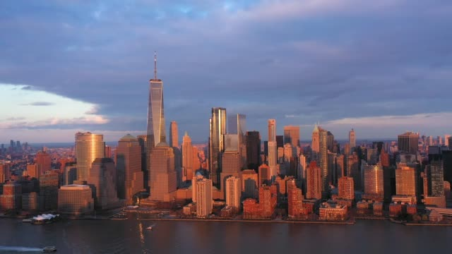4K Aerial photograph of New York with the Hudson Rivers at Sunset, Manhattan financial District Aerial photograph of New York with the Hudson Rivers at Sunset, Manhattan financial District new york city skyline stock videos & royalty-free footage