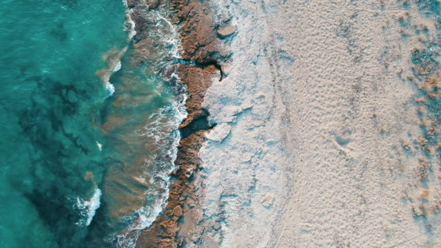 Aerial photograph of the beach and Turquoise colored sea video