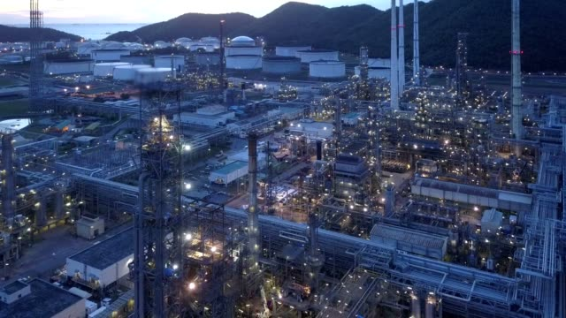 aerial photographs of oil refineries plants, gas tank, oil tank. - centrale elettrica video stock e b–roll