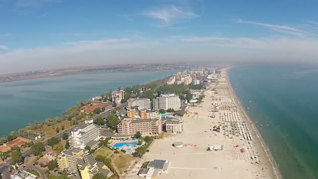Aerial presentation of the main strip of Mamaia holiday resort area, a top travel destination in summer , on the Black Sea Coast , Romania.