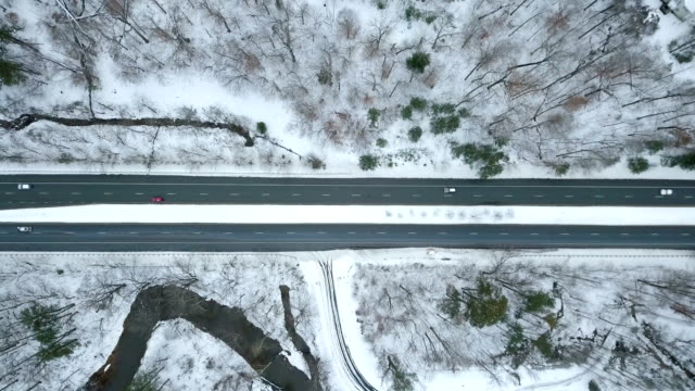Aerial Pullback Shot of Cars on Snowy Road