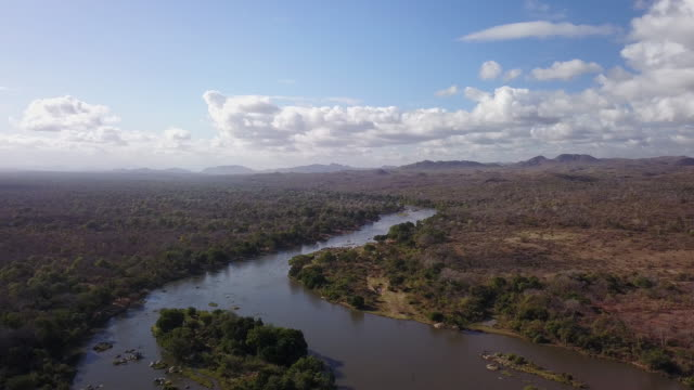 Aerial Pulling Back Over River And Plains In Africa – film