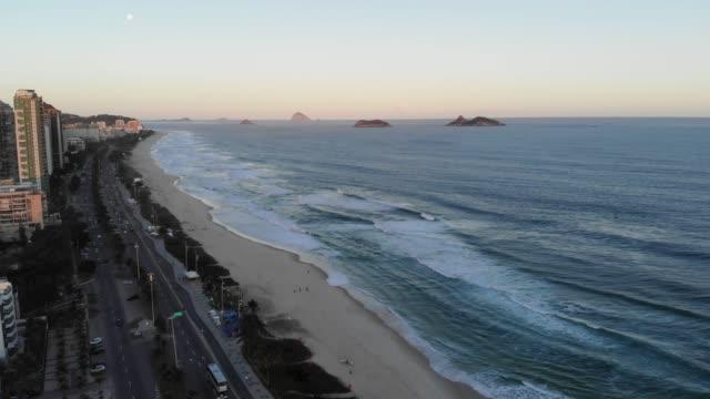 Aerial Push in view Barra da Tijuca beach during sunset . Rio de Janeiro, Brazil video
