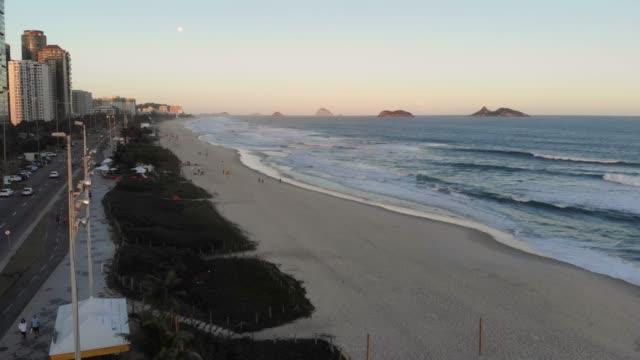 Aerial Push Out View Barra da Tijuca beach during sunset . Rio de Janeiro, Brazil video