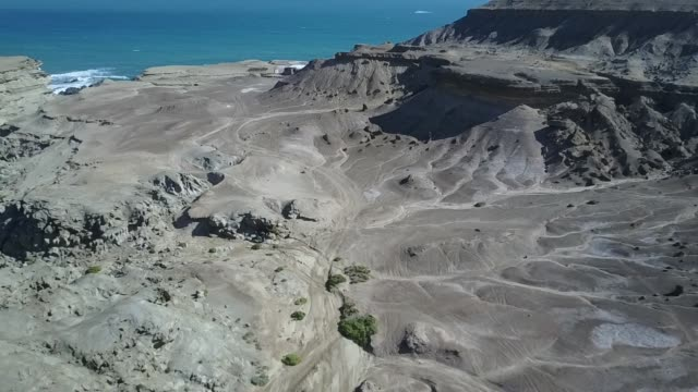 Aerial raw footage view of Atacama Desert coastal area at Chorrillos beach an amazing rugged landscape for geology with incredible sand formations, cliffs and geological faults on Earth, awe scenery