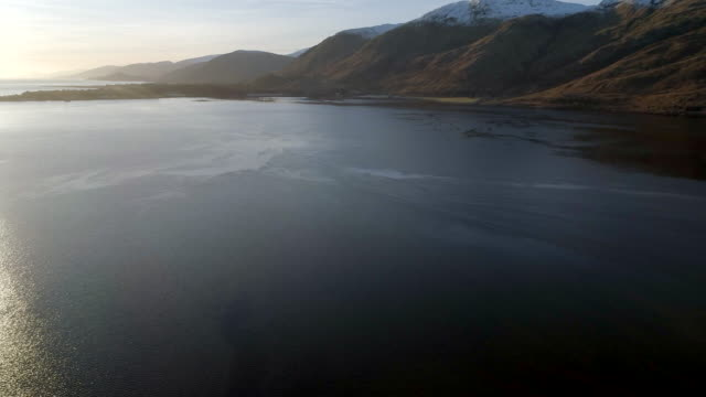aerial reveal of a scottish loch - fort william video stock e b–roll