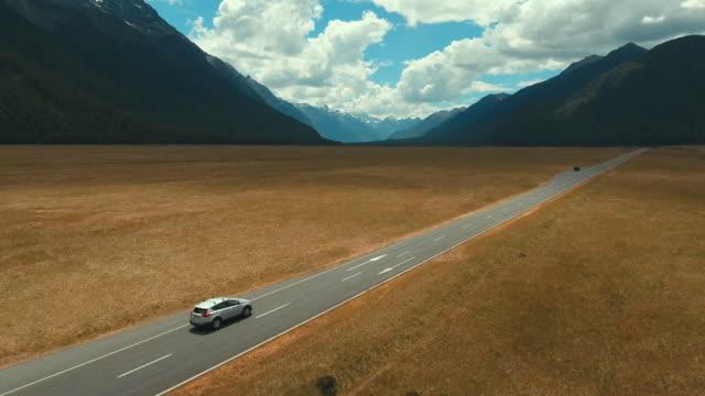 aerial road trip - сельская дорога стоковые видео и кадры b-roll