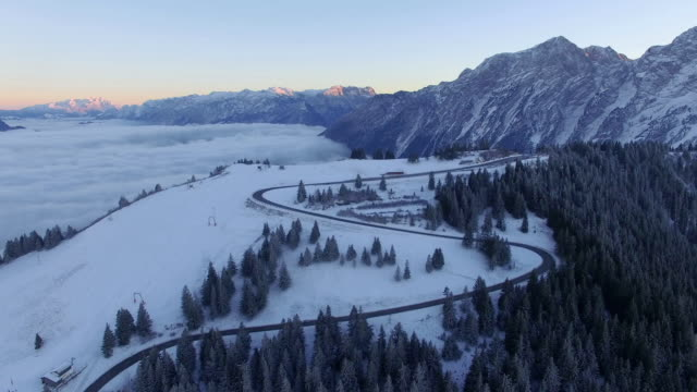 Aerial: Rossfeld, Bavaria, at sunrise in winter video