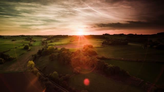 aerial : rural countryside in germany at sunrise - eifel - paesaggio collinare video stock e b–roll