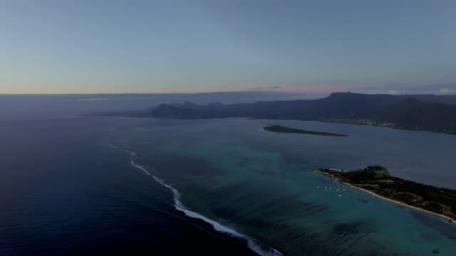 aerial scene of mauritius with mountain ranges and blue ocean - isole mauritius video stock e b–roll