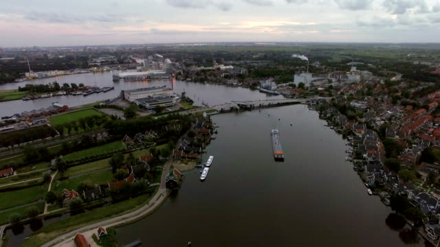 Aerial scene of town and river in Netherlands video