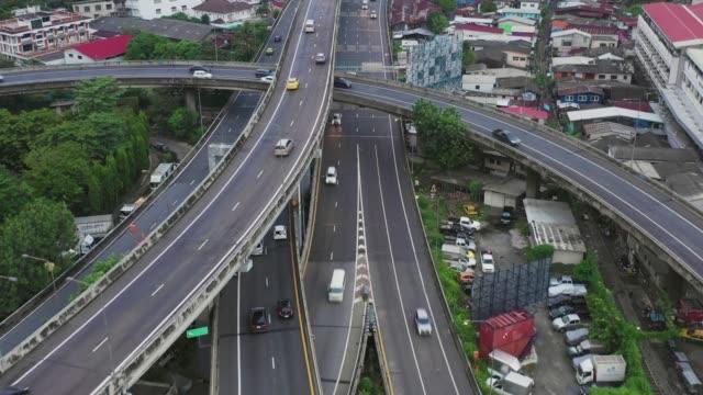 aerial scene of urban road in 4k  multiple lane highway in bangkok thailand traffic jam in twilight, nightmultiple lane highway in bangkok thailand - fiume chao phraya video stock e b–roll