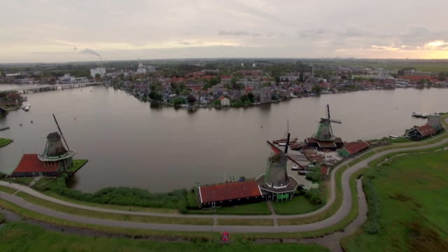 Aerial scene with windmills and township in Netherlands Aerial shot of village near Amsterdam with old windmills and green fields, Netherlands netherlands stock videos & royalty-free footage