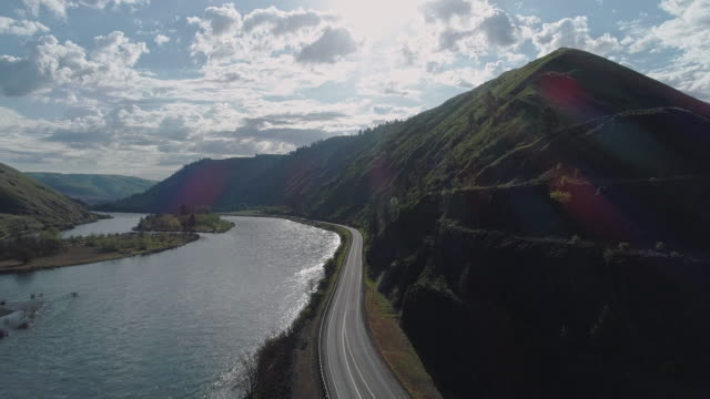 Aerial scenic view of the Northwest Passage Scenic Byway along Clearwater River nearby Culdesac, Idaho. Drone video with the cinematic slow forward camera motion.
