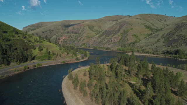 Aerial scenic view of the Northwest Passage Scenic Byway along Clearwater River nearby Culdesac, Idaho. Drone video with the cinematic slow forward camera motion. - vídeo