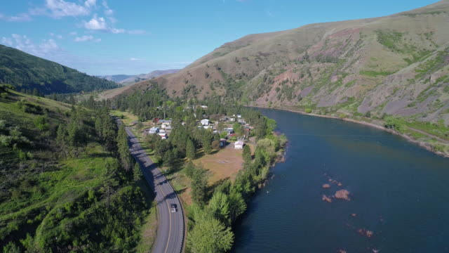 Aerial scenic view of the Northwest Passage Scenic Byway along Clearwater River nearby Culdesac, Idaho. Drone video with the cinematic backward camera motion. - vídeo