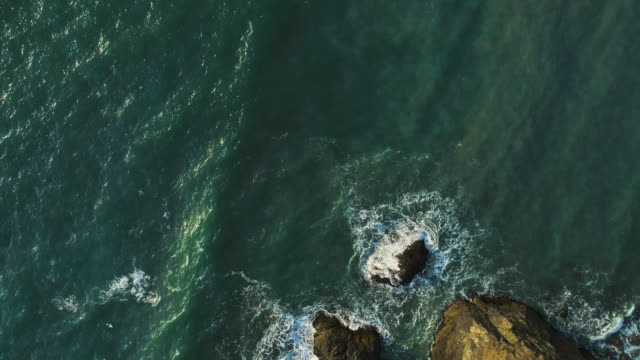 Aerial scenic view of the rocky Oregon coast nearby Brookings, USA West coast. Looking down, directly-above drone video.