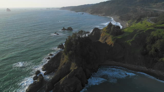 Aerial scenic view of the rocky Oregon coast nearby Brookings, USA West coast. Drone video with the slow descending camera motion.