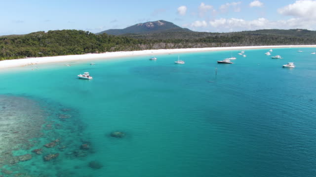 Aerial: Several shots of world-famous Whitehaven Beach located in the Whitsundays. Accessible from Airlie beach. Queensland, Australia.
