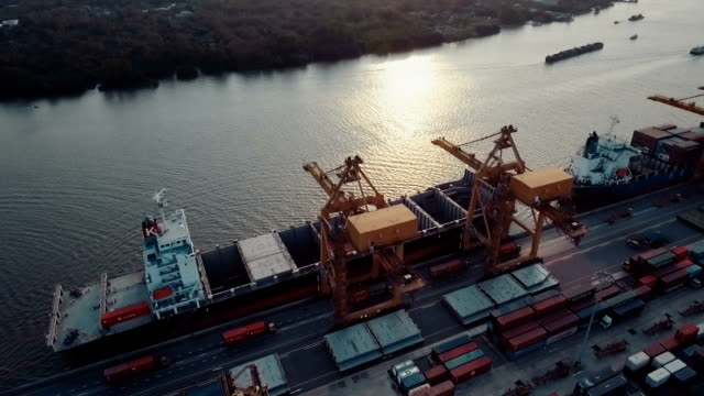 Aerial shipping port cargo at sunset video