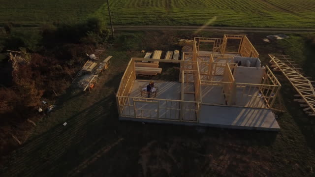 Aerial shoot, architects looking at building plans Aerial shoot, architects looking at building plans craftsman architecture stock videos & royalty-free footage