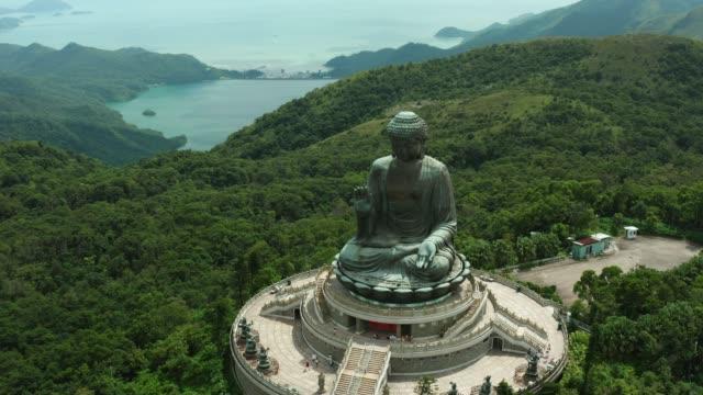 aerial shoot of tian tan buddha in hong kong - buddha video stock e b–roll