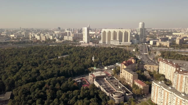 Aerial shooting from flying drone city park and residential buildings video