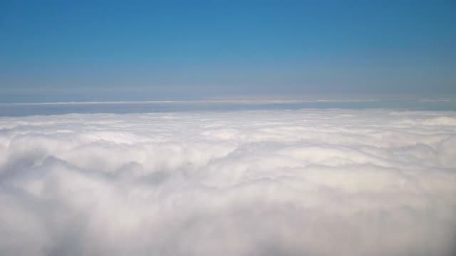 Aerial shot above the clouds in 4K slow motion 60fps Professional video aerial shot above the clouds in 4K slow motion 60fps daylight savings stock videos & royalty-free footage