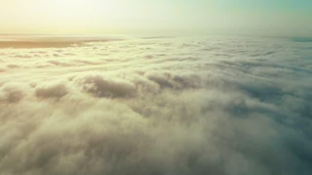 Aerial shot above the clouds in 4K.
