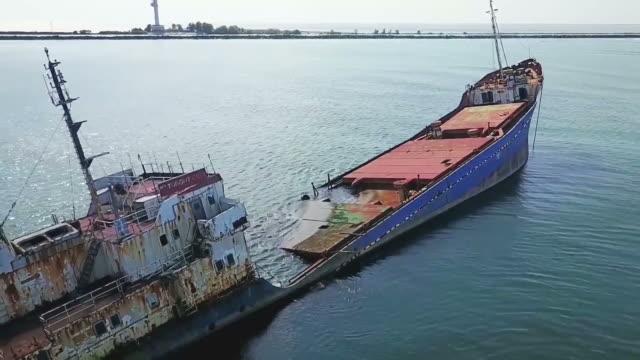Aerial shot along the damaged cargo shipwreck in Danube Delta , near Sulina City, Black Sea coast, Romania video