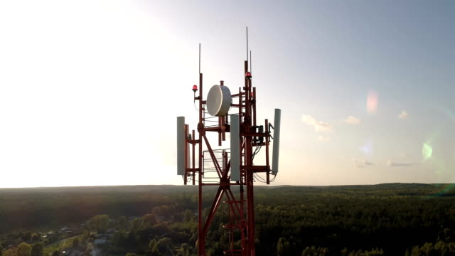 Aerial shot around of telecom tower in a rural