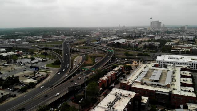 aerial shot ascending over a freeway junction near downtown san antonio, texas - san antonio texas stock videos & royalty-free footage