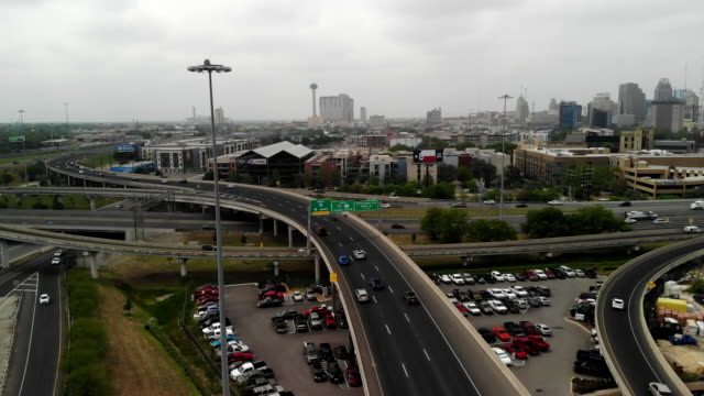 aerial shot ascending over the 281 and 35 freeways in san antonio, texas and revealing downtown - san antonio texas stock videos & royalty-free footage