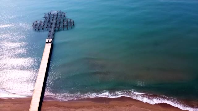 aerial shot coast and pier with drone