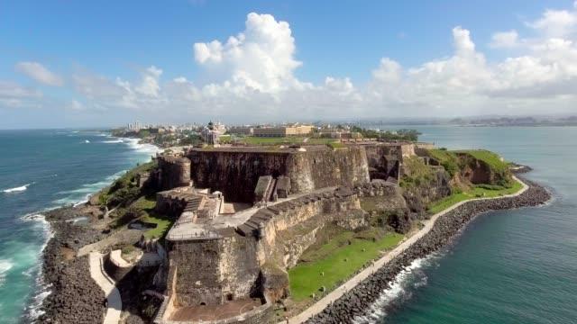 Aerial shot coming in from the ocean towards El Morro fort in Old San Juan, PR Daytime aerial shot coming in from the ocean towards El Morro fortress in Old San Juan, Puerto Rico puerto rico stock videos & royalty-free footage