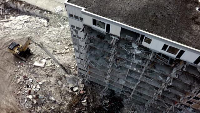 Aerial shot demolition crane dismantling a building video
