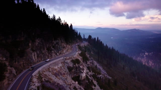 Aerial Shot Following Winding Road Above Valley in California Sierra Nevada video