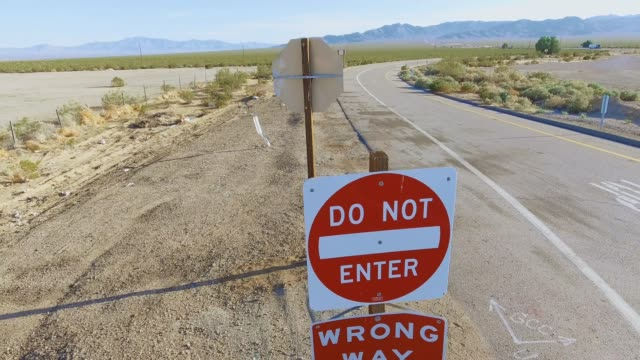 Aerial shot from Do Not Enter signs to landscape between California & Nevada video