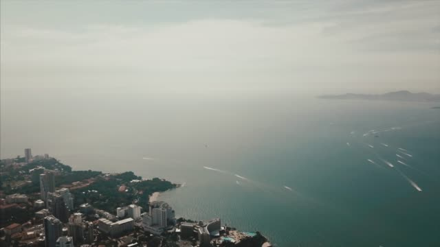 aerial shot in the morning above the beach and sea with many tourist and boats. video. beautiful landscape, aerial view - pattaya filmów i materiałów b-roll