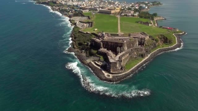 Aerial shot moving from the ocean and into El Morro in Old San Juan, Puerto Rico video