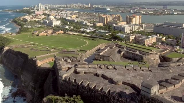 Aerial shot moving into Old San Juan, Puerto Rico from El Morro fortress video