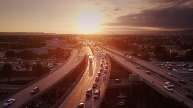 aerial shot of 10/110 interchange, los angeles at sunset - città diffusa video stock e b–roll
