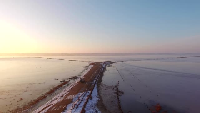 Aerial Shot of a car driving on Kuyalnik Estuary, Odessa, Ukraine video