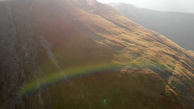Aerial shot of a Carpathian Mountain slope with a nice rainbow in FullHD