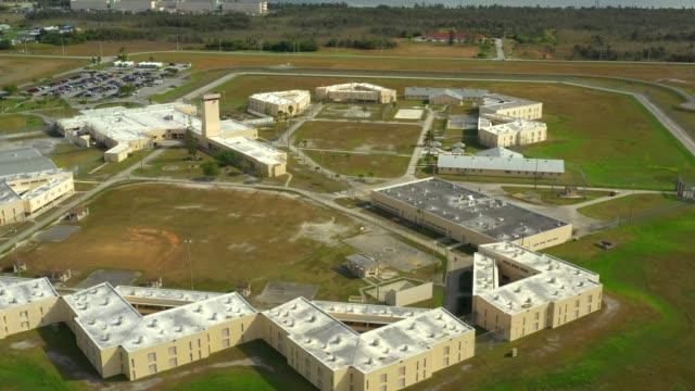 aerial shot of a generic prison correctional detention center - prigione video stock e b–roll